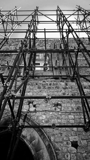 Architecture Blackandwhite Photography Tourism Travel Photography Outdoors Italy Building Exterior Earthquake Town Stone Damaged Ruins Reconstruction Building Umbria Façade Metal Structure Outdoor Photography Cable Electricity  Technology Clear Sky Sky Scaffolding Construction Crane Desolate Urban Scenery