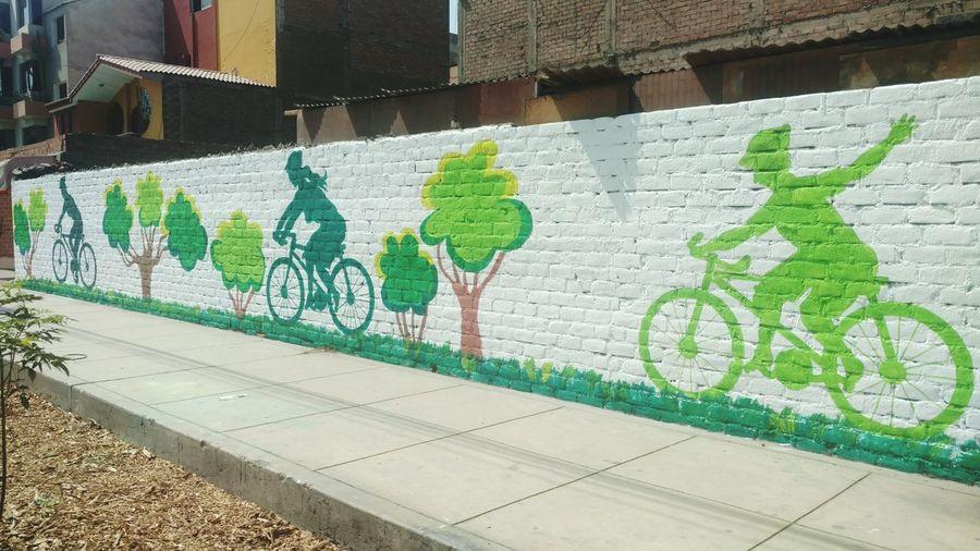 Graffiti Art And Craft Green Color Street Art Text Day Outdoors Multi Colored No People Architecture City Bicicletta Bicycle Graffiti Graffiti Art