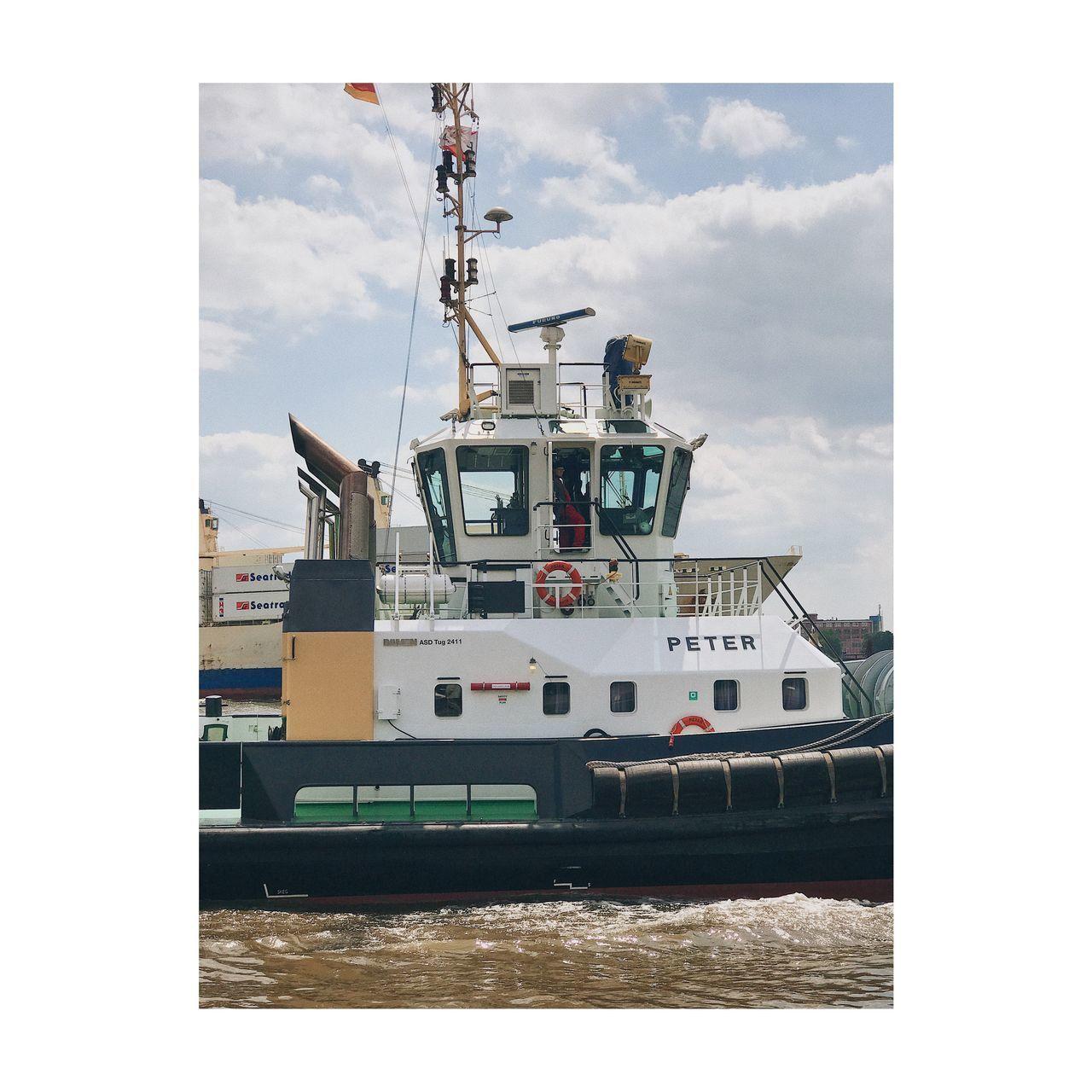 SHIP MOORED AT SEA SHORE AGAINST SKY