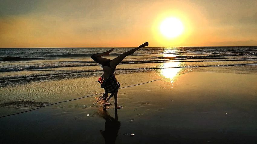 Sunset Silhouette Reflection Water Sea One Person Sun Nature Beach Sky Horizon Over Water Scenics Outdoors Beauty In Nature Art Day Artistic Photo Lifestyles Passion Young Women Inkedgirls Relax Nature Beautifulinnature Naturalbeauty Photography Landscape Handstands Jumping