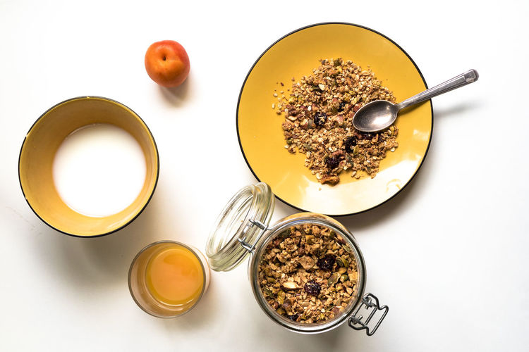 Breakfast. Muesli and fruits Apricot Bowl Breakfast Cereal Close-up Directly Above Food Freshness Fruits Granola Healthy Food Healthy Lifestyle Juice Milk Muesli No People Orange Color Overhead View Ready-to-eat Serving Size Still Life Studio Shot White Background