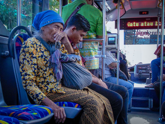 on the bus Bus Transjogja Sitting Men Women Togetherness Senior Adult Happiness Warm Clothing Business Finance And Industry Metro Train