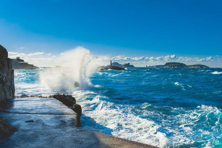 Sea waves splashing on concrete floor