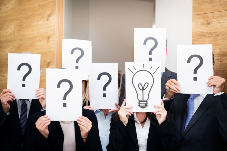 Business Doubt Icon Office Teamwork Text Business Person Businessman Businesswear Businesswoman Caucasian Concept Group Group Of People Group Shot Idea Indoors  Men People Portrait Question Question Mark Team Togetherness Women