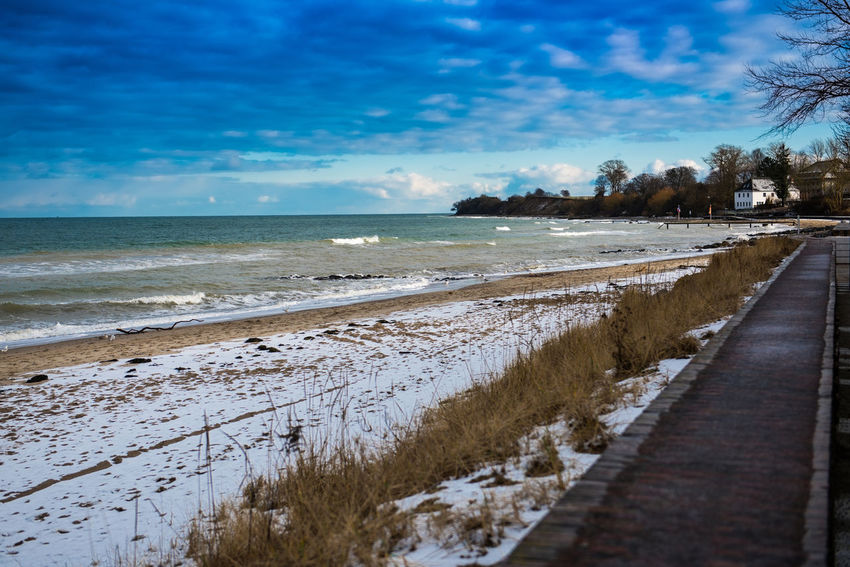 Brodtener Ufer Niendorf, Ostsee Winter Beach Beauty In Nature Cloud - Sky Cold Temperature Day Go-west-photography.com Landscape Nature No People Outdoors Scenics Sea Sky Snow Tranquil Scene Tranquility Tree Water Winter
