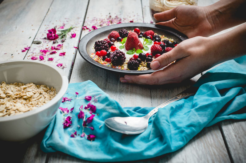 sunny, spring morning, lets eat breakfast Breakfast Morning Sunny Day Fruit Human Hand Healthy Lifestyle Bowl Close-up Food And Drink Yogurt Granola Berry Fruit Raspberry Seed Blackberry Blackberry - Fruit Red Currant Corn Flakes Blueberry Breakfast Cereal Oats - Food Oat Flake