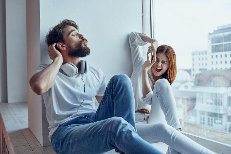 Young couple looking at camera at home