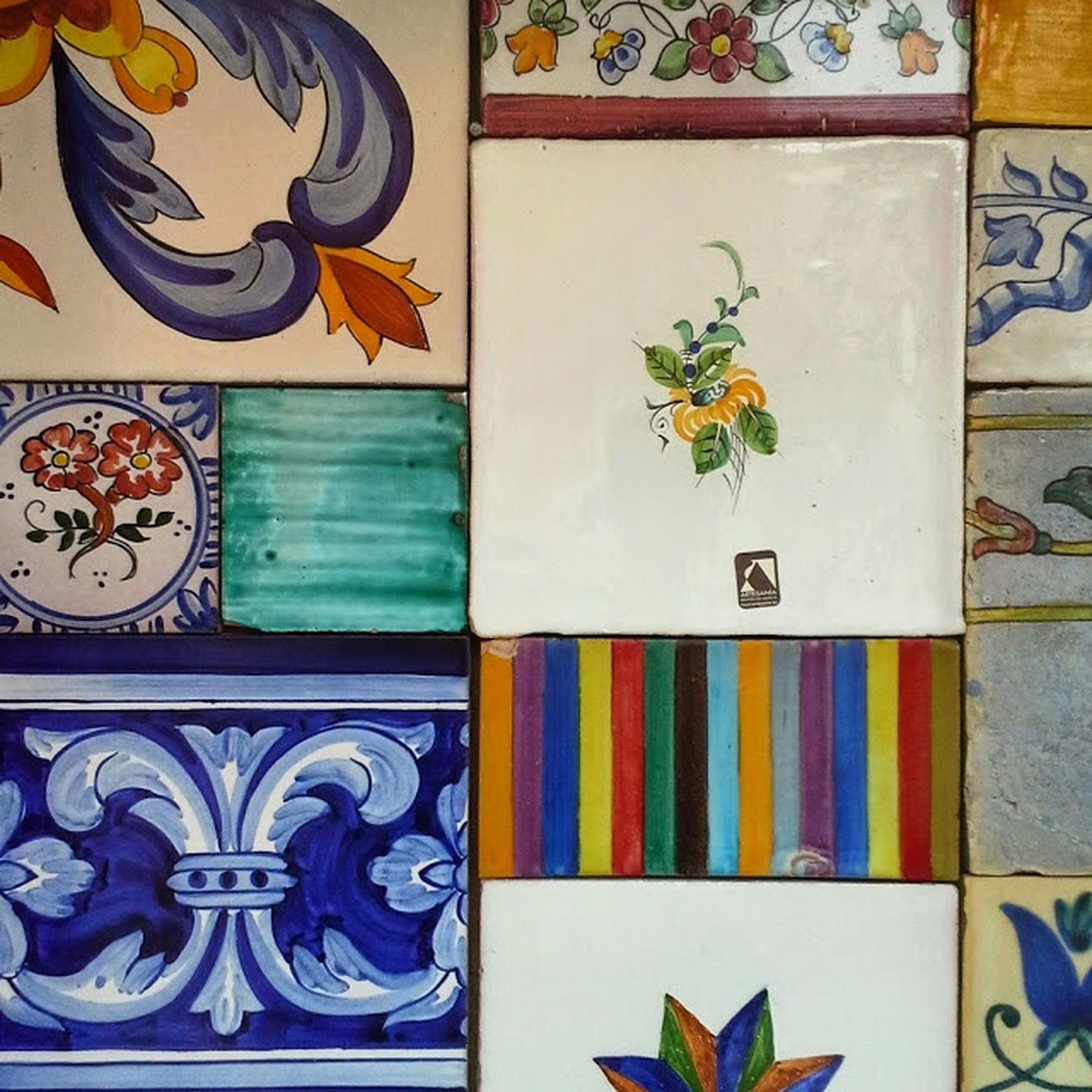 art and craft, art, creativity, multi colored, indoors, variation, design, wall - building feature, colorful, still life, full frame, pattern, backgrounds, floral pattern, painting, close-up, craft, wall, human representation, animal representation
