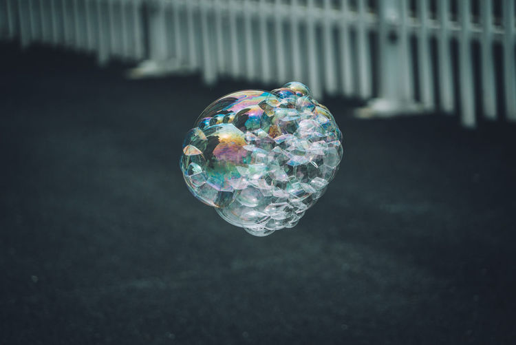 Close-Up Of Bubbles Over Street