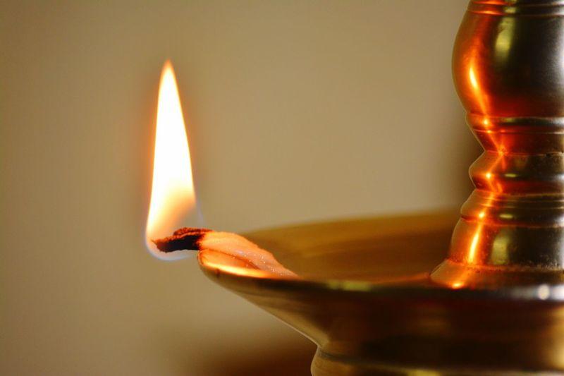 Close-Up Of Illuminated Diya