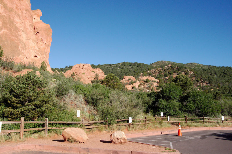 Garden of the Gods Animal Animal Themes Beauty In Nature Blue Clear Sky Copy Space Day Fence Garden Of The Gods Land Landscape Landscapes Mammal Mountains Nature No People Outdoors Plant Rock Rock - Object Rock Formation Scenics - Nature Sky Sunlight Tree
