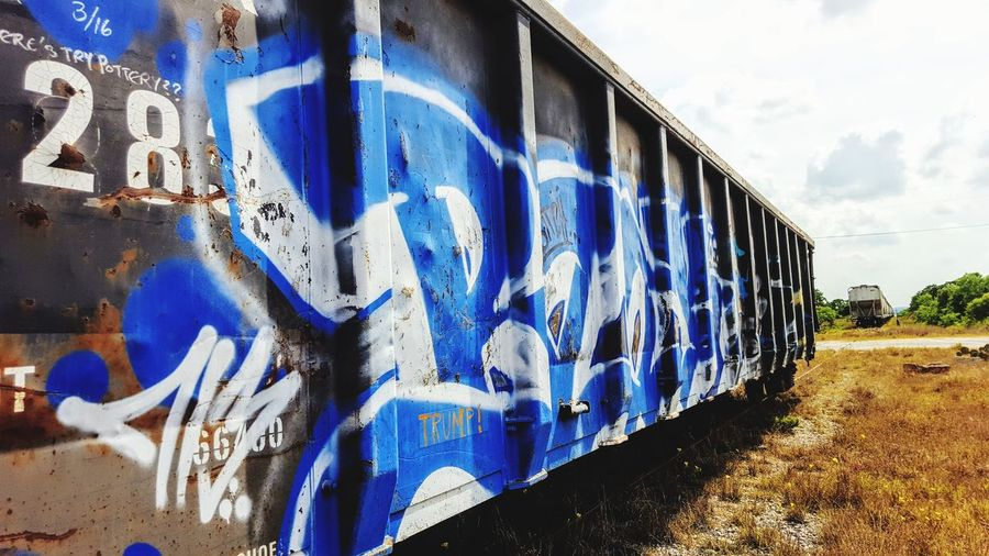 graffiti on a train Train Train - Vehicle Blue Sport Sky Architecture Close-up Building Exterior Built Structure Spray Paint Paint ArtWork Painted Painter - Artist Representation Paint Can