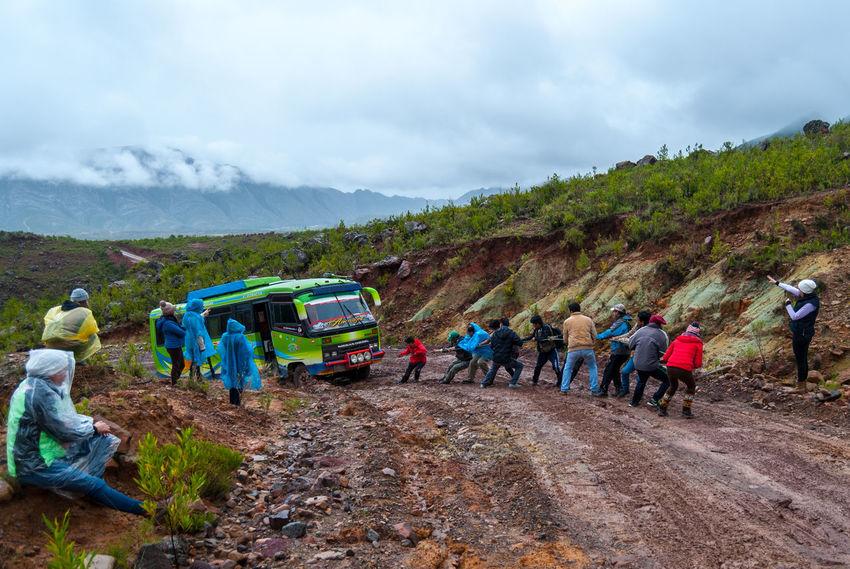 Tug of wins? Bolivia Tug Of War Adult Bus Cloud - Sky Day Men Mountain Mountain Range Mud Nature Occupation Outdoors People Real People Sky Stuck Torotoro Working