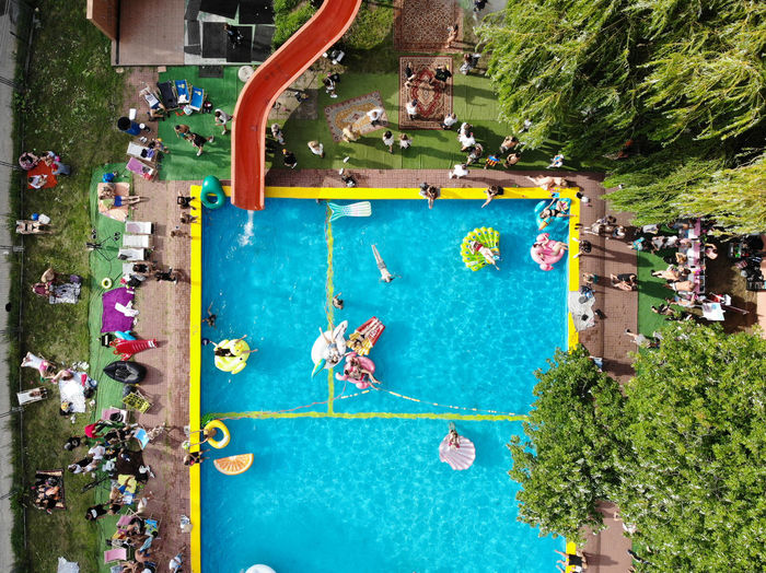 High angle view of people by swimming pool