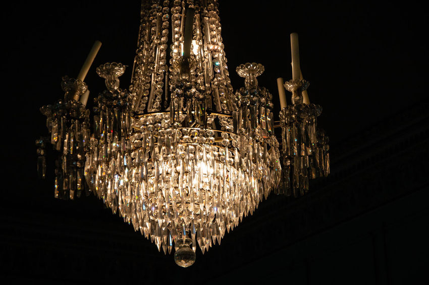 Black Background Ceiling Chandelier Close-up Crystal Glassware Dark Electric Lamp Electric Light Electricity  Glass Glowing Hanging Illuminated Indoors  Large Group Of Objects Light Lighting Equipment Low Angle View Luxury No People Ornate Pendant Light Wealth