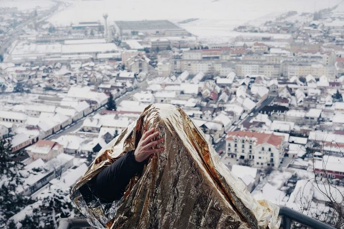 High Angle View One Person One Man Only City Cityscape Warm Clothing Snow Cold Temperature Winter Business Finance And Industry TOWNSCAPE Town Old Town Tiled Roof  Stories From The City