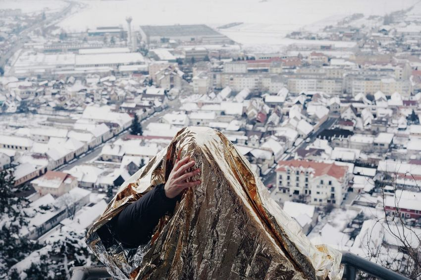 High Angle View One Person One Man Only City Cityscape Warm Clothing Snow Cold Temperature Winter Business Finance And Industry TOWNSCAPE Town Old Town Tiled Roof