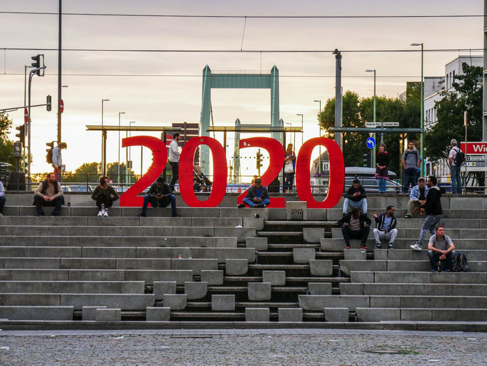 #urbanana: The Urban Playground Mühlheim Adult Architecture Available Light Building Exterior Built Structure City Crowd Day Group Of People Large Group Of People Lifestyles Men Outdoors Real People Red Sky Staircase Street Streetphotography Text Transportation Women