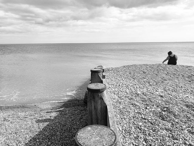 Sea Beach Water One Person Horizon Over Water Nature Outdoors Day Real People Beauty In Nature Blackandwhite Pevensey Bay Pebble Wood