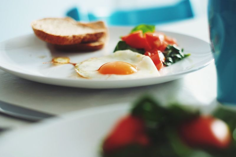 Close-Up Of Fresh Breakfast Served In Plates On Table