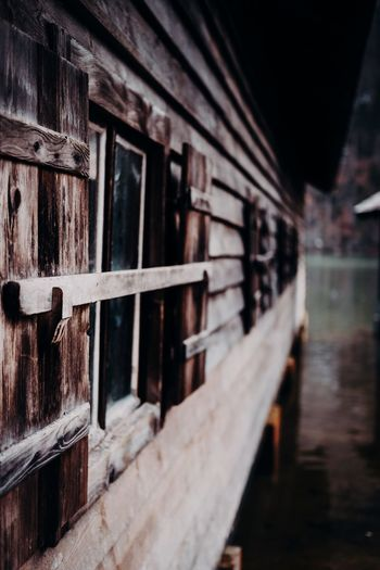 The old cabin by the sea Lakeside Naturelovers Nature Tranquility Cabin No People Built Structure Architecture Wood - Material Selective Focus Day Window Metal Close-up Transportation Building Exterior Reflection Old Outdoors Pattern Railing Focus On Foreground Nature In A Row