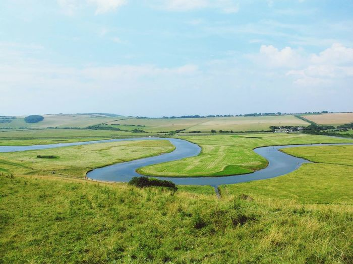 Seven Sister Grass Green Color Landscape Field Scenics Sky Tranquil Scene Growth Nature Travel Destinations Beauty In Nature Travel Lifestyles Nature Beauty In Nature Day No People Outdoors Tranquility Water Golf Course