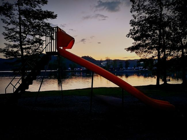 The day is almost over... Tree Water Sky Outdoors No People Slide - Play Equipment Sunset Silhouettes Lakeside.