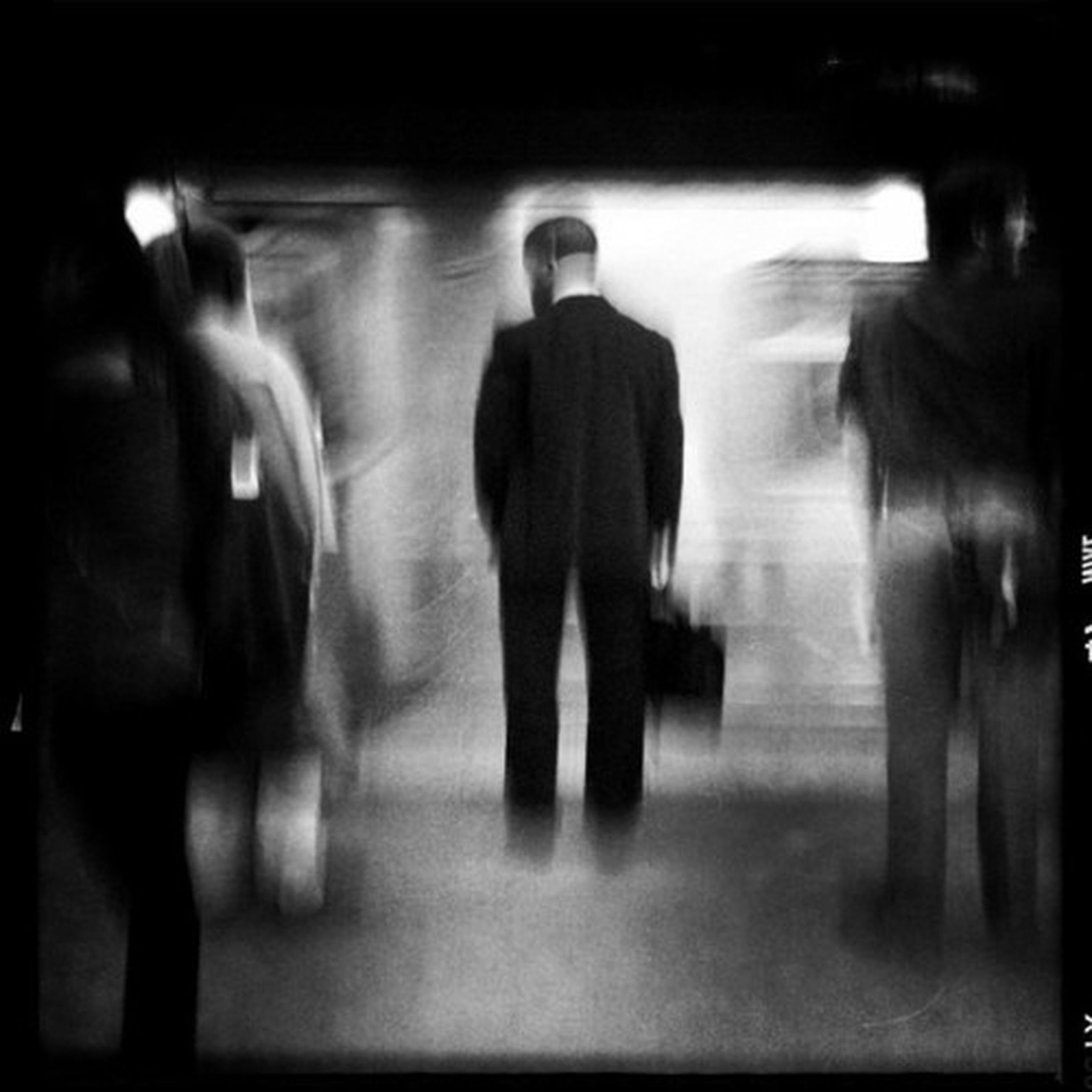 indoors, men, lifestyles, person, illuminated, walking, standing, blurred motion, night, rear view, leisure activity, silhouette, unrecognizable person, reflection, on the move, flooring, full length