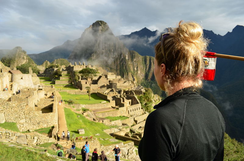 Rear view of young woman looking at machu picchu
