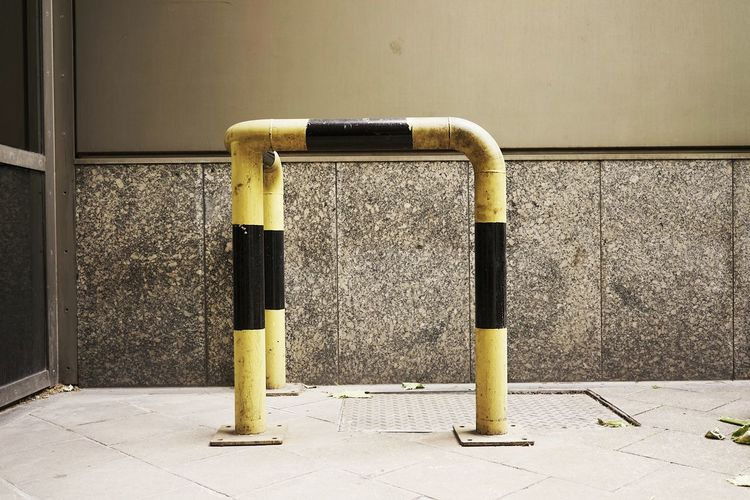 Metal barricade by manhole in front of door