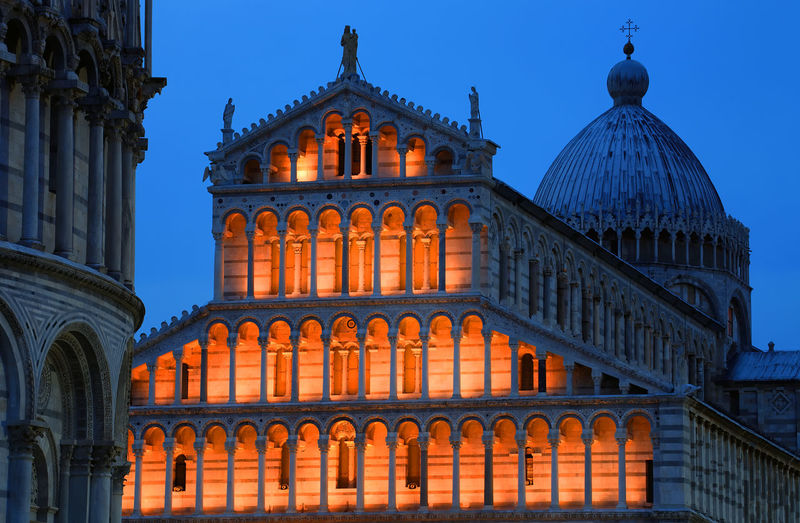 Low angle view of illuminated pisa cathedral against clear sky