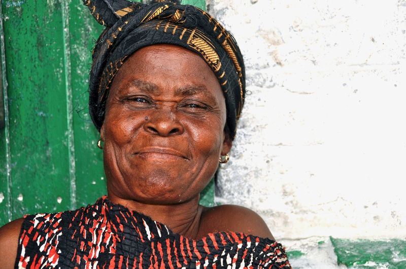 One Person Portrait Real People Adult Headshot Front View Looking At Camera Women Females Mature Adult Casual Clothing Wrinkled Social Issues Smiling Face African Faces Of Africa Poverty Developing Country Cheerful Ghana Woman Portrait Elderly Woman Headscarf Market Vendor
