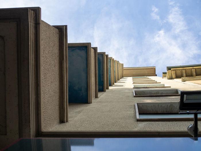 Row of buildings against blue sky