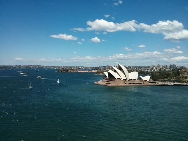 The Sydney Opera House from Afar. · Sydney Opéra Building Architecture pseudo-Aerial Sunny Day Clouds And Sky Yeah
