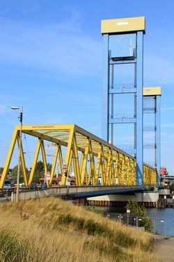 Nature Yellow Color Blue Sky Beauty In Nature Sunlight Sunshine Outdoors Focus On Foreground Kattwykbridge Tall - High Road Sings Grass Roadways Footbridge Lift Bridge Water River Elbe ♥️ City Blue Sky Architecture Built Structure Railway Bridge Railroad Bridge Rail Transportation Bridge - Man Made Structure