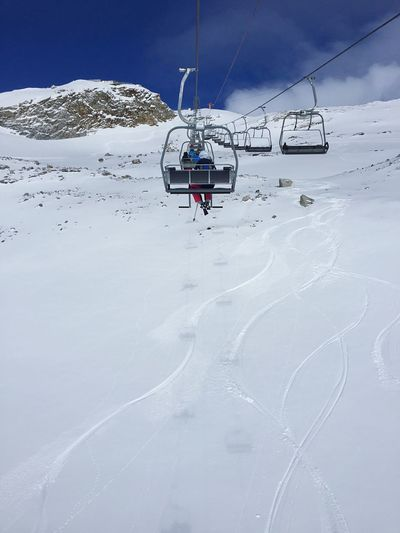 Overhead cable car in snow covered mountain