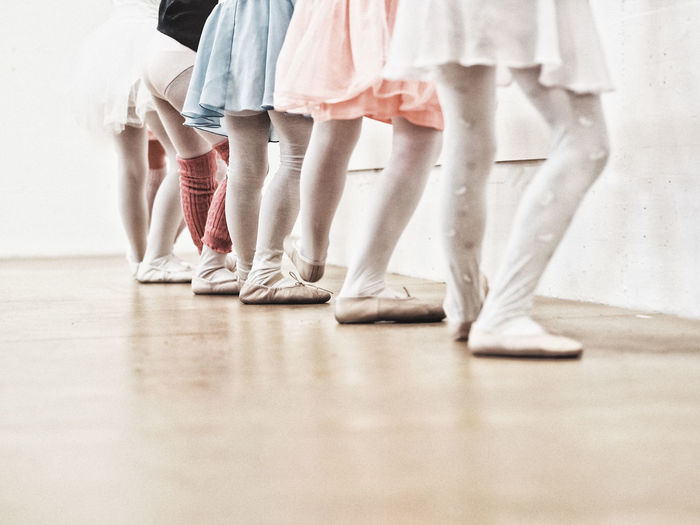 Low Section Of Ballet Dancers Practicing In Studio