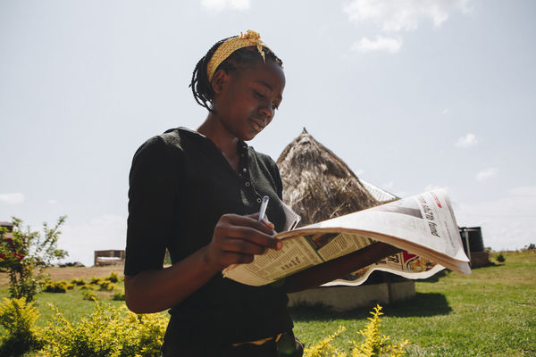 Adults Only Africa African Education Entrepreneur Entrepreneurship Healthy Lifestyle Learning Lifestyles Low Angle View Mpigi Newspaper One Person Outdoors Reading Reading Rural Rural Life Sina Studying Woman Woman Portrait Young Adult Young Woman Young Women