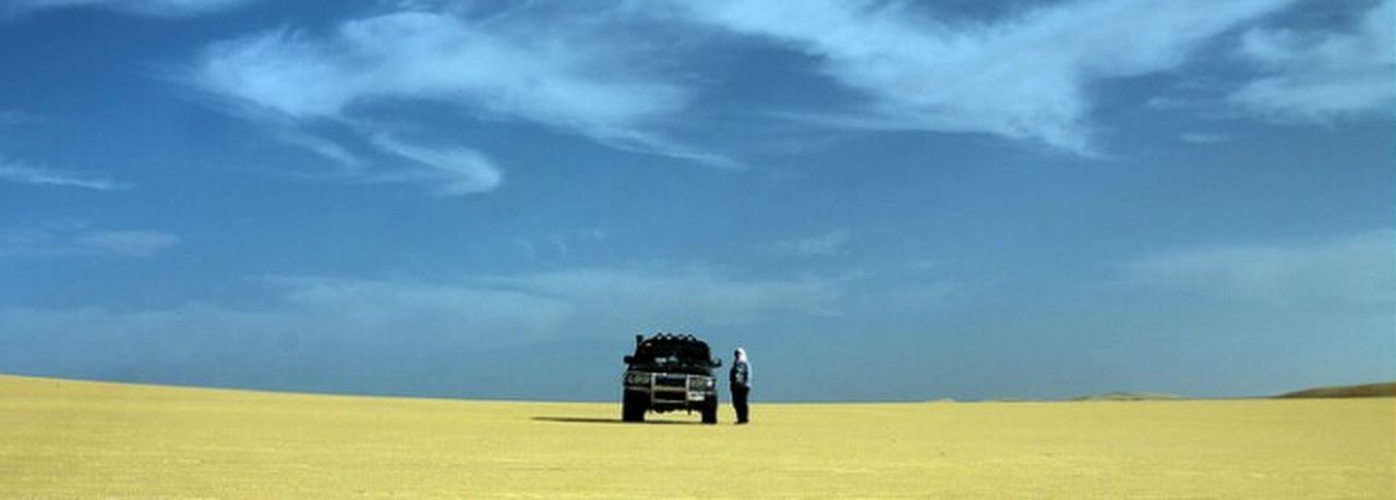landscape, sky, travel destinations, cloud - sky, transportation, desert, travel, outdoors, land vehicle, day, road, scenics, yellow, arid climate, rural scene, no people, beauty in nature, nature, grass, tree, oil pump
