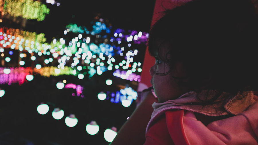 curiousity of the baby Christmas Lights Close-up Portrait Blurred Background Matte Baby Bokeh Photography Curiousity Night Nightphotography Illuminated Multi Colored Wireless Technology Defocused Women Close-up Camera Photographer Taking  Self Portrait