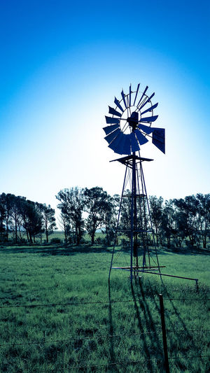 Sound of the wind ~ Windpomp Farmland Farm Outdoors Blue Sky Green Iron Structure Pumping For Water Trees Beautiful Day Contrast Landscape Blades Wheel Rotary Indwe South Africa Eastern Cape Showcase: February Barbed Wire