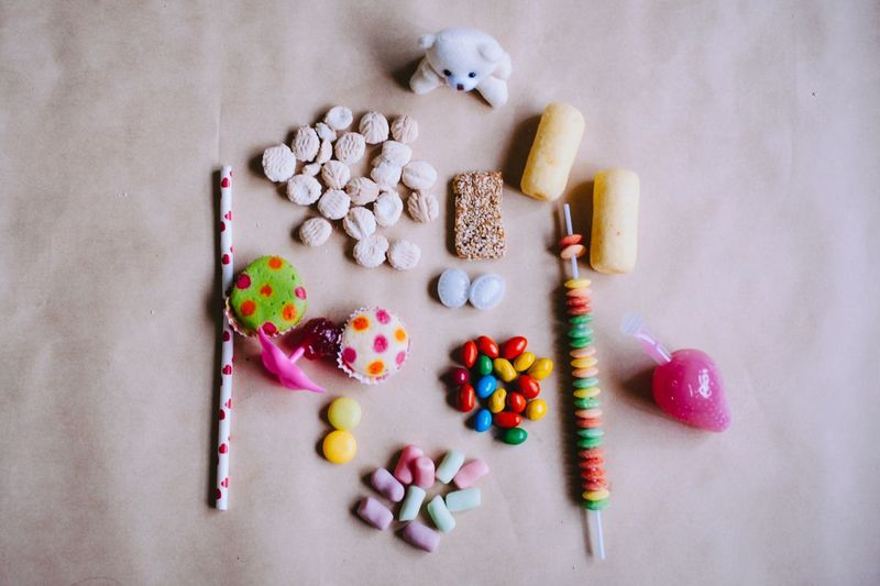 High Angle View Of Teddy Bear With Candies