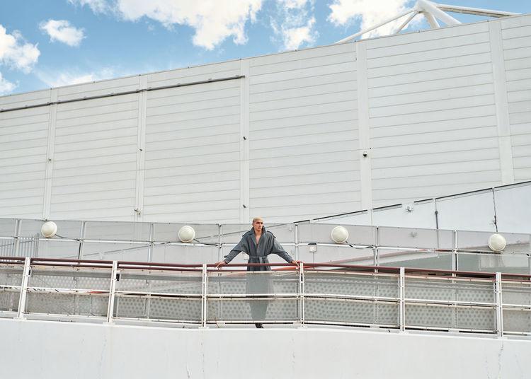 Full length of man standing on boat deck