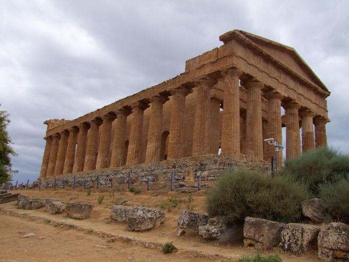 Doric Temple of Concord (5th century BC) 5th Century BC Agrigento Ancient Ancient Civilization Bushes Composition Culture Day DoricTemple Grey Sky Historic History Italy No People Religion Ruined Sicily Temple Tourist Attraction