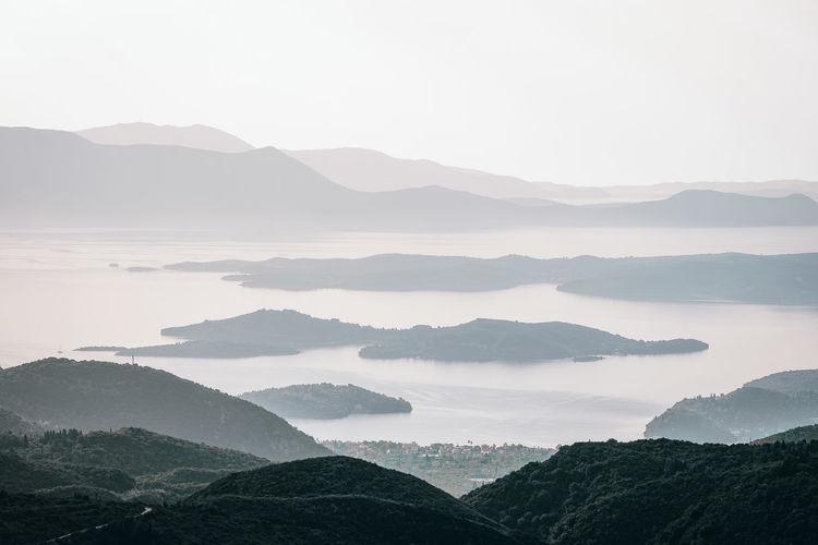 Nature Island Islands Mountain Fog Forest Lake Tree Water Landscape Mountain Range Shore Scenics Atmospheric Mood Overcast