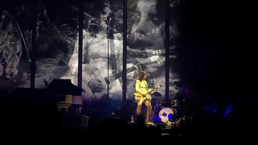 Lana Del Rey Event Night Arts Culture And Entertainment Indoors  Music Performance Illuminated Enjoyment Glass - Material Real People Light - Natural Phenomenon Silhouette Dark Men Lighting Equipment Window Smoke - Physical Structure Stage Popular Music Concert Festival