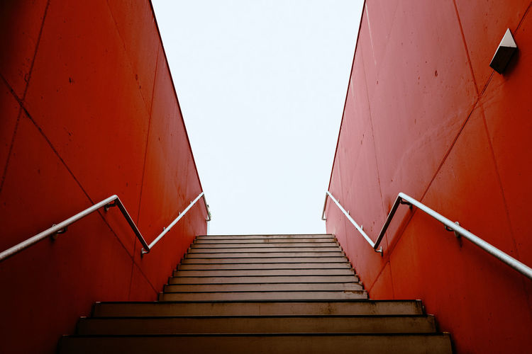 17.62° Red Architecture Built Structure Wall - Building Feature No People Day Staircase Steps And Staircases Railing Low Angle View Direction The Way Forward Sky Clear Sky Moving Up Nature Building Exterior Outdoors Building Diminishing Perspective My Best Photo The Architect - 2019 EyeEm Awards