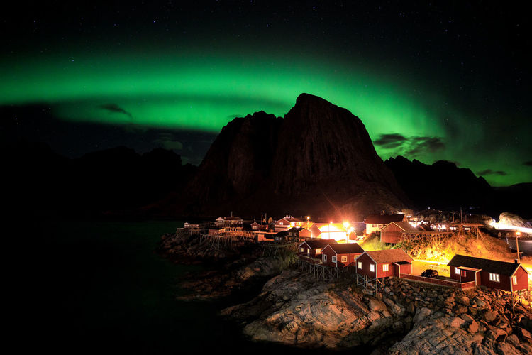 Northern lights over the vilage of Hamnoy, Lofoten, Norway Night Beauty In Nature Illuminated Scenics - Nature Sky Nature Mountain No People Star - Space Glowing Tranquil Scene Environment Idyllic Green Color Tranquility Water Landscape Land Rock Lofoten Polar Light Aurora Aurora Borealis Norway Lofoten Islands