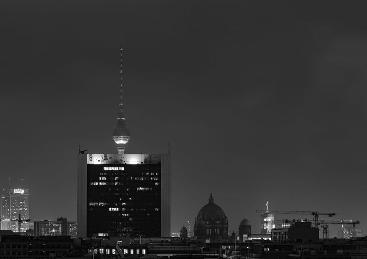 Communications Tower In City At Night
