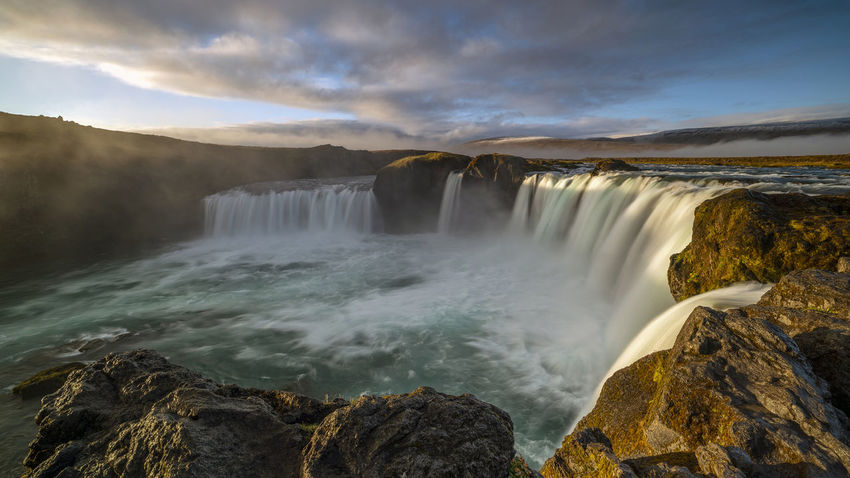 The Goðafoss is a waterfall in Iceland. It is located in the Bárðardalur district of Northeastern Region at the beginning of the Sprengisandur highland road. The water of the river Skjálfandafljót falls from a height of 12 meters over a width of 30 meters. Scenics - Nature Water Beauty In Nature Waterfall Motion Long Exposure Nature Flowing Water No People Outdoors Power In Nature Flowing Goðafoss Waterfall Sunrise Sunset Environment Blurred Motion Majestic Beauty In Nature Horseshoe Falls Rocks Rock Sky Cloud - Sky Rock - Object Idyllic Solid Non-urban Scene Running Water